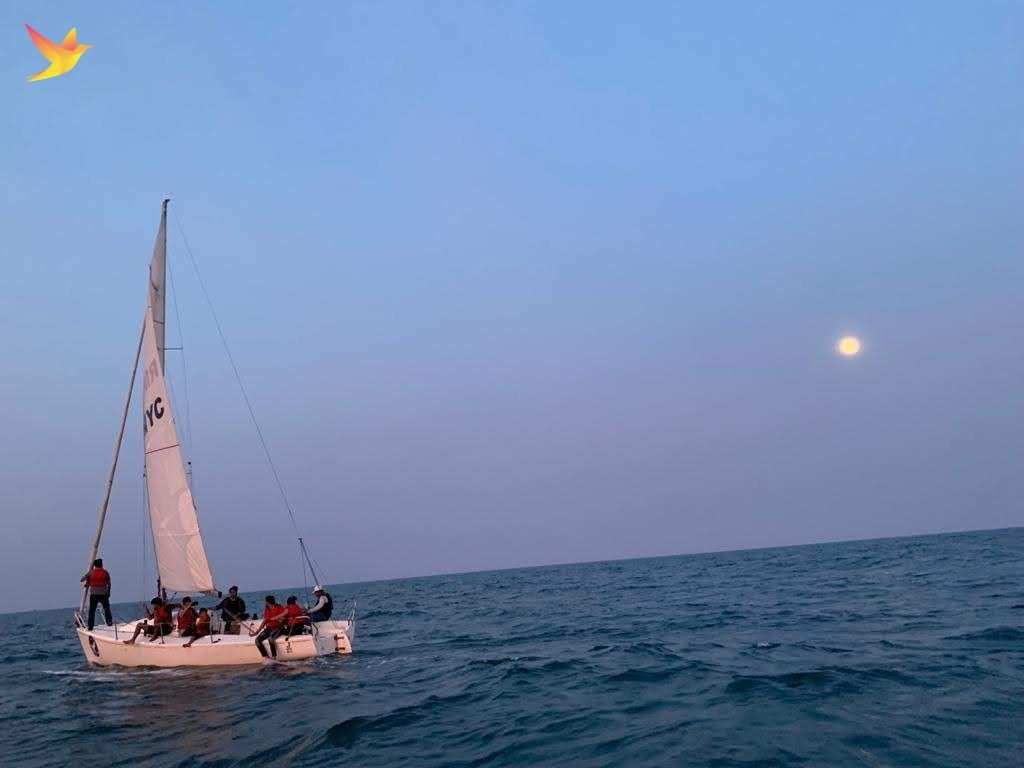 Sailors enjoying the full moon rise